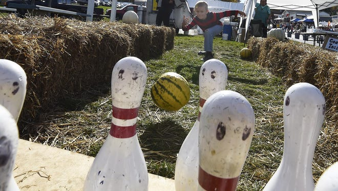 Jeffrey Rekucki of St. Francis, Minn., shows perfect form on his way to a strike in the pumpkin bowling at last year's Sister Bay Fall Fest.