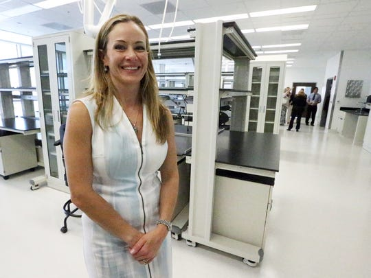 Emma Schwartz, president of the Medical Center of the Americas Foundation, stands Friday in a large research lab inside the new Cardwell Collaborative biomedical research building at 5130 Gateway Blvd. East in Central El Paso.