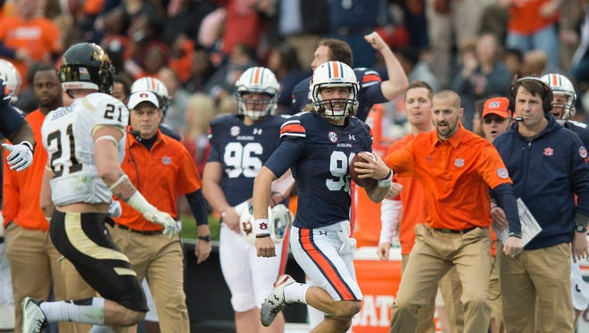 Auburn Tigers punter Kevin Phillips (91) runs for a first down on a fake punt during the NCAA football game between Auburn and Idaho on Saturday, Nov. 21, 2015, at Jordan-Hare Stadium in Auburn, Ala.Albert Cesare / Advertiser