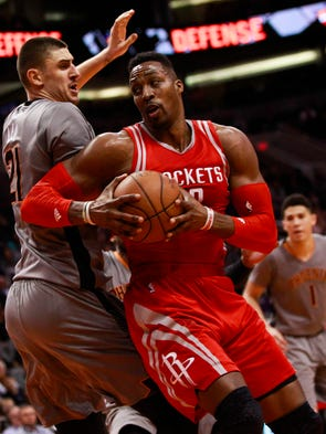 Houston Rockets center Dwight Howard drives to the