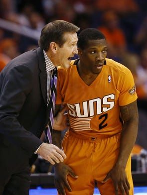 Phoenix Suns coach Jeff Hornacek talks to Eric Bledsoe against the Detroit Pistons on Friday, March 21, 2014 at US Airways Center in Phoenix.
