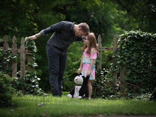 Matt Hearn talks to his daughter Josephine, 9, with