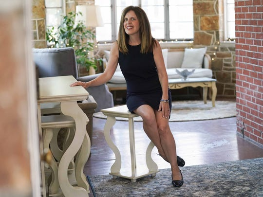 """Denise Nordheimer wears a $29 navy sheath dress from Target that she bought six of, two in each color. She keeps one set in Wilmington and one in Milton. """"another thing I purchased in several colors."""""""