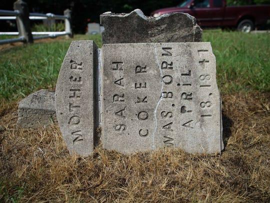 The broken headstone of Sarah Coker, great-grandmother