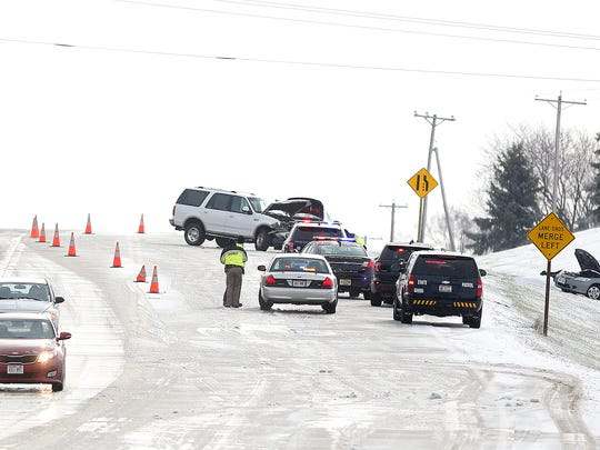 Emergency crews investigate a two-vehicle crash on