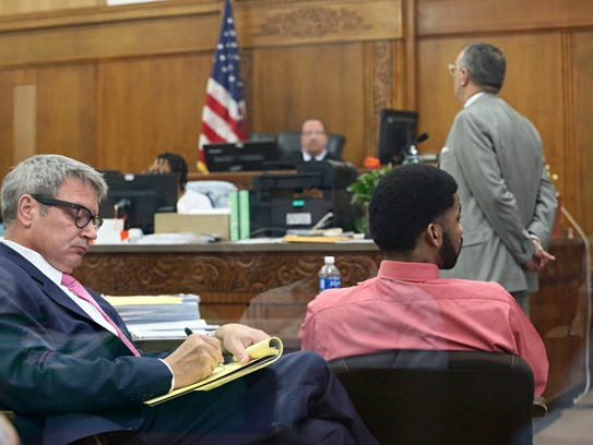 Dominique Heaggan-Brown, right, and his attorney Jonathan