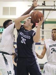 Redwood's Andres Solis goes up against El Diamante's