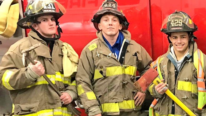 Members of the Grand View University Wrestling team spent their Friday night at the Richland Township Fire Department  waiting for a new bus. They had just won their sixth straight National Dual Championship a few hours earlier, then tried on firefighters uniforms.