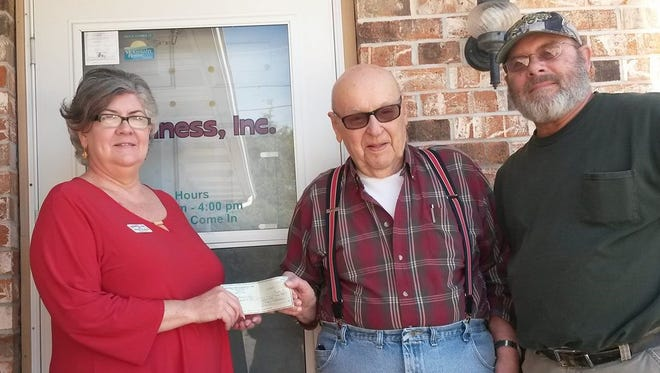 The Fraternal Order of Eagles 3183 Aerie recently donated $3,000 in support of Kindness, Inc., in Mountain Home. The funds were raised from the group's annual Hog Roast. Debbie Wamock (from left)Executive Director of Kindness, Inc., accepted the donation from Ron Kern, member in charge of the event and Scot Parker, Eagles Aerie resident.This was the ninth year the Eagles have held the fundraiser for Kindness, Inc. Wamock thankedthe hard working members of the Eagles Aerie in Midway.