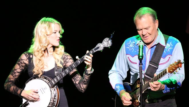 "Glen Campbell, right, and Ashley Campbell appear in the documentary ""Glen Campbell: I'll Be Me."""