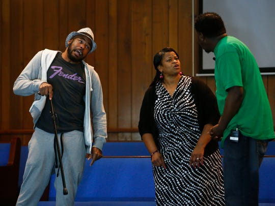 """James Scott (from left to right), Teresa James and Mark Cobb rehearse a scene from """"Lord Can You Hear Me?"""" at Latter Rain Church of God on Tuesday evening."""
