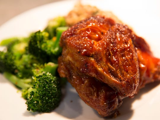 Barbecue chicken, with steamed broccoli and dirty rice