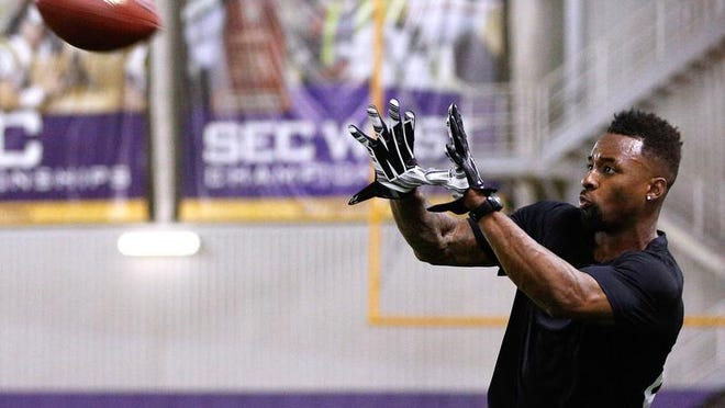 LSU wide receiver Jarvis Landry catches the ball during NFL football pro day Wednesday in Baton Rouge. (AP Photo/Jonathan Bachman)