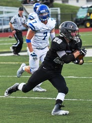 East's Jake Waranauckas (with ball) turns up the field