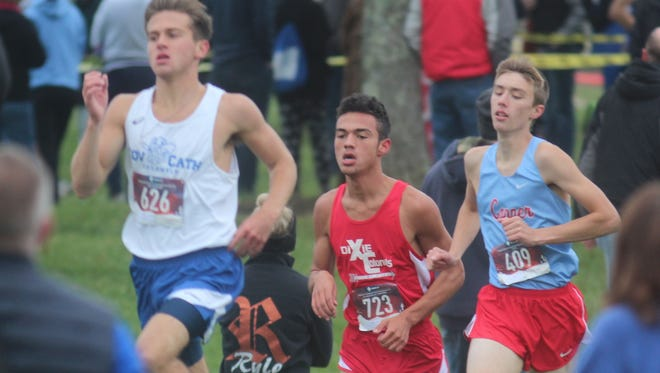 Covington Catholic senior Will Tate, Dixie Heights senior Alex Sanchez and Conner junior Robbie Notton during the Northern Kentucky Athletic Conference cross country championships Oct. 13, 2018 at Idlewild Park in Burlington, KY.