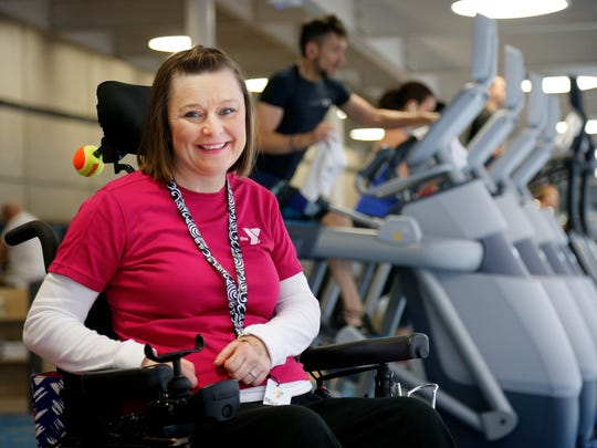 Michele Meadors of Des Moines, who was paralyzed in a 2011 crash, believes there is a need for strong oversight as Iowa Medicaid administration shifts to managed-care companies. She is shown at the downtown YMCA on April 8.