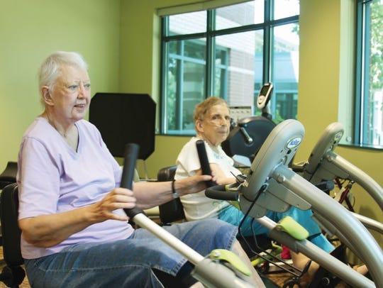 Carol Wilson, left, and Carolyn Payne use the machines