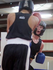 Old Skool Boxing Club fighter Ezekiel Sandoval, right,