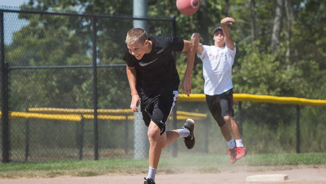 Community members and workers with Open Door Health Services play sandlot kickball on Aug. 27 at the Yorktown Sports Park. The organizations wellness committee has been trying to organize the outings as a way to promote a more active lifestyle.