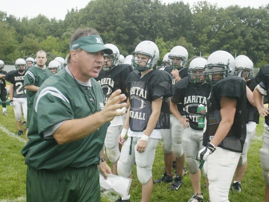 Bob Generelli talks to his Raritan players during a summer practice in 2004. The Rockets would go on to their only undefeated season in school history that year.