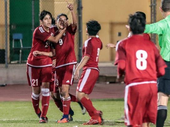 Desert Mirage's Jesus Gutierrez, #9, makes a goal against