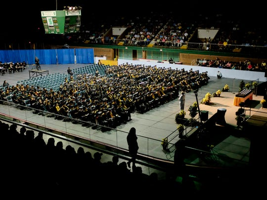 Graduates listen during the opening remarks during SC4's 2015 commencement ceremony at McMorran Arena.