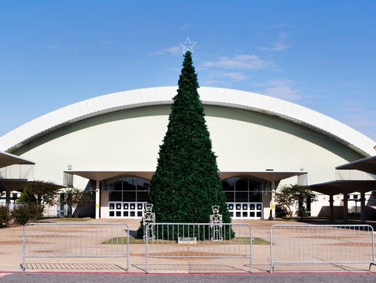 A Christmas tree stands in the plaza at the Monroe Civic Center. The tree will be illuminated during an annual tree lighting ceremony Saturday at 6 p.m.