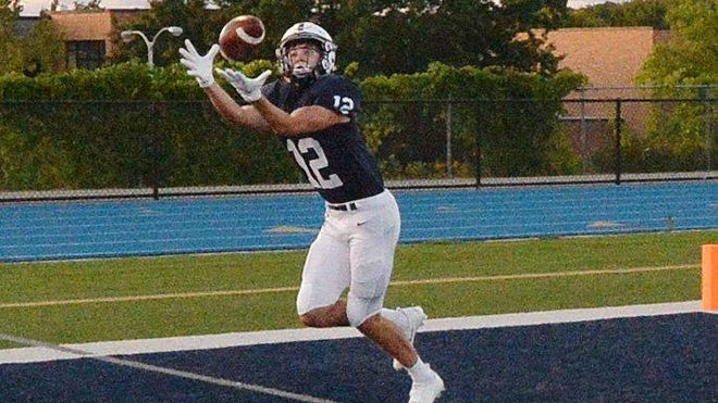 McDowell senior Braeden Soboleski catches what would have been a first-quarter touchdown pass against Erie High, but the play was called back due to a penalty at Gus Anderson Field on Sept. 11, 2020, in Millcreek Township. Our Call picks the Trojans as a 7-point favorite over Cathedral Prep on Friday.
