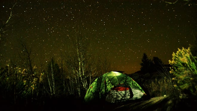 Campers sleep in a tent under the stars in Rocky Mountain National Park.