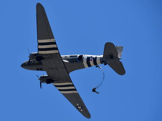 A member of the Liberty Jump Team parachutes from a C-47 aircraft during Saturday's WASP Homecoming at the National WASP WWII Museum in Sweetwater. Five former Women's Airforce Service Pilots attended the event.