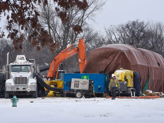 Crews work from a location on the east bank of the Mississippi River as part of a new gas main installation across the river Friday, Jan. 13, in Sartell.