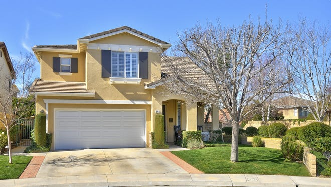 Located on a quiet cul-de-sac at 641 Camino De La Luz in Newbury Park, this home's front yard has a manicured lawn, glorious shade tree, neatly-trimmed foliage and a veranda at which to sit and enjoy morning coffee.