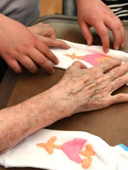 The hands of Hardy fourth grader Lizzy Partin help