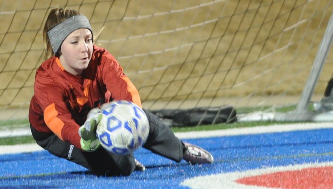 Lubbock High goalie Payton Adams makes a stop on Hayden Abor's penalty kick. It was the freshman's second straight stop to give the Lady Westerners a 4-3 victory over Cooper in a shootout on Friday, Feb. 3, 2017 at Shotwell Stadium.