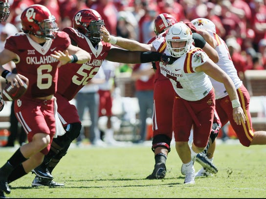 Iowa State LB/QB Joel Lanning (7) is blocked by Oklahoma offensive lineman Erick Wren (58) as he chases quarterback Baker Mayfield (6) in the third quarter of an NCAA college football game in Norman, Okla., Saturday, Oct. 7, 2017. Iowa State won 38-31. (AP Photo/Sue Ogrocki)
