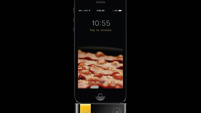 A new Oscar Mayer campaign lets you wake up to the smell of bacon, by way of a device and app tie-in for iOS.