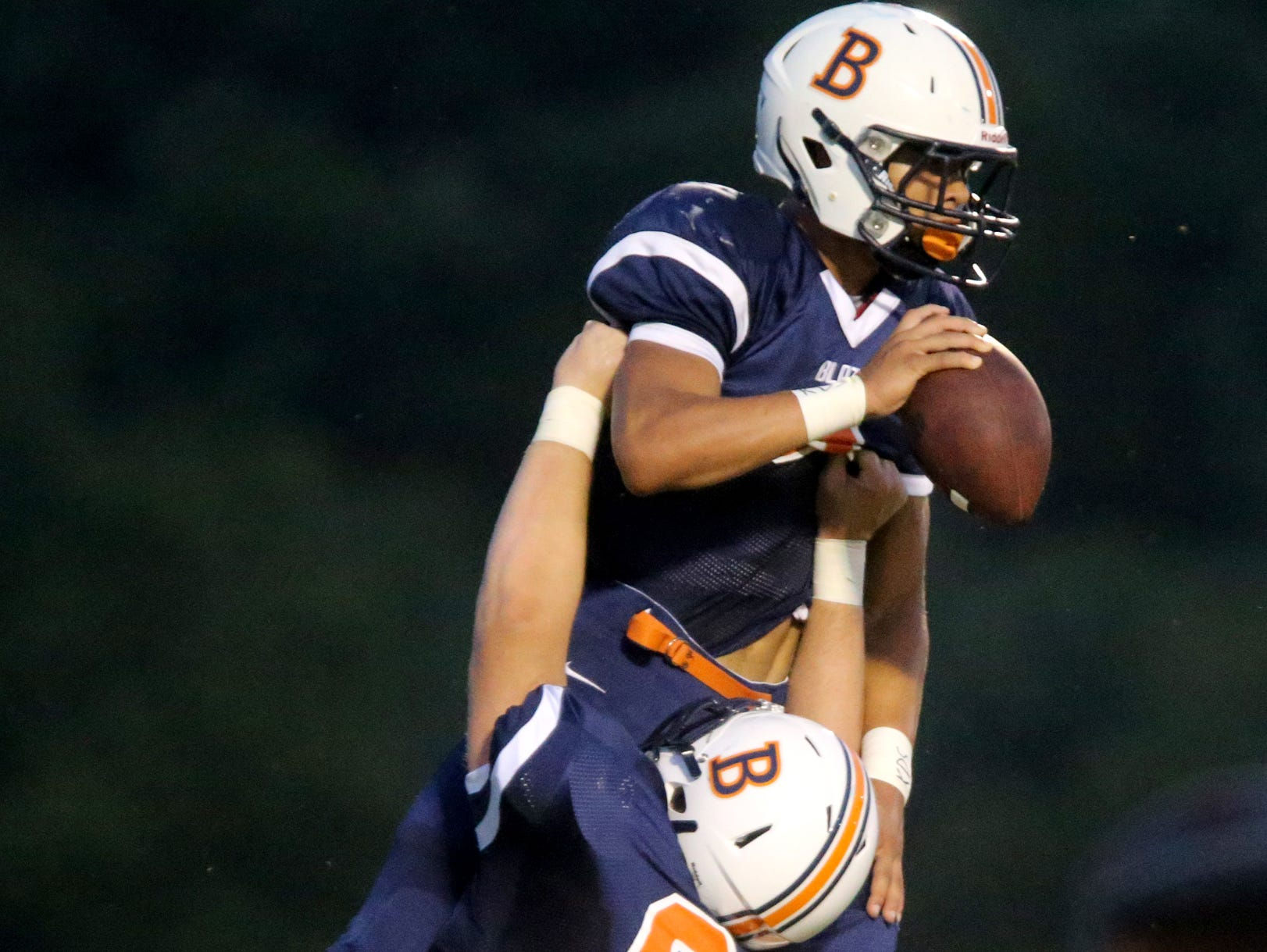 Blackman's Camron Curtis (65) hoists teammate Taeler Dowdy (3) in the air after Dowdy scored a touchdown Friday.