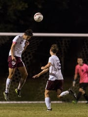 Henderson's Aaron Wayne (17) takes a header during the game against the Hopkinsville Tigers at Colonel Field in Henderson, Ky., on Tuesday, Sept. 19, 2017. The Colonels and the Tigers tied, 5-5.