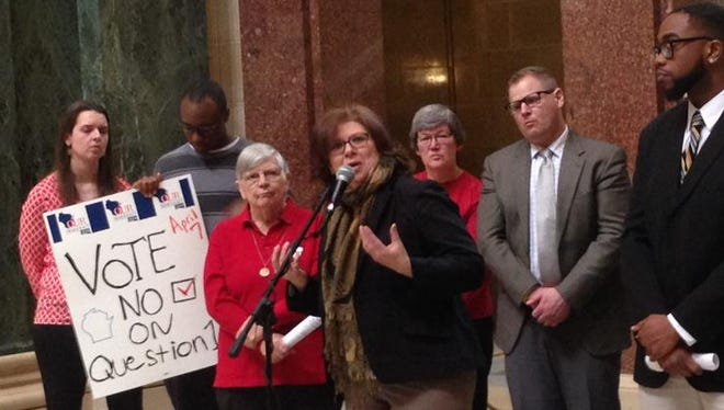 Former Wisconsin Attorney General Peg Lautenschlager, center, speaks against a constitutional amendment that would change how the state's chief justice is chosen.