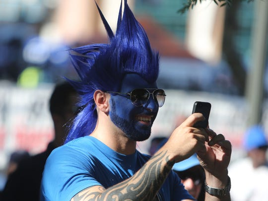 Detroit Lions fans with their faces painted in 2014 (again).