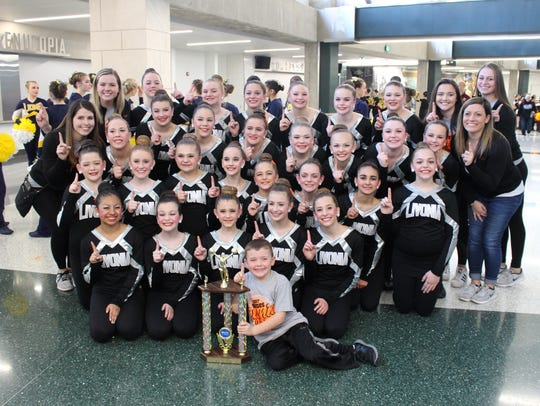 Members of Livonia Pom are all smiles after winning