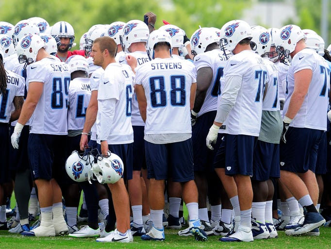 Titans players huddle before the start of practice at St. Thomas Sports Park Thursday Aug. 7, 2014, in Nashville, Tenn.