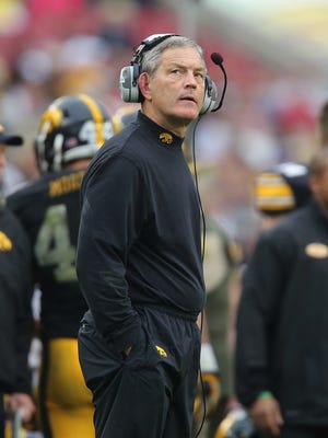 Iowa coach Kirk Ferentz looks up at the big screen to watch a replay against LSU in the Outback Bowl.