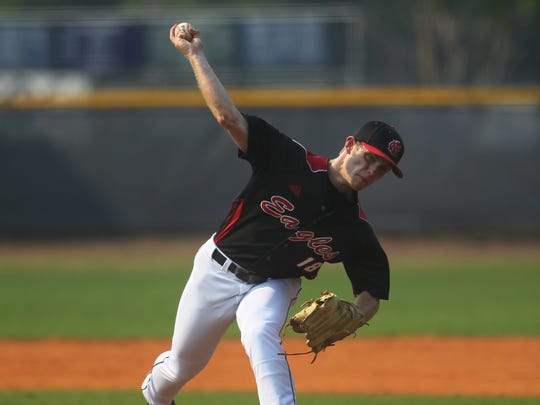NFC's J.D. Tease fires a pitch Tuesday against Maclay.