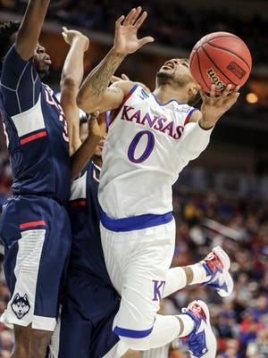 Frank Mason III of Kansas drives to the hoop during the Kansas vs. Connecticut NCAA men's basketball tournament second round game on Saturday, March, 19, 2016 at Wells Fargo Arena.