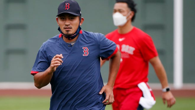 Red Sox infielder Tzu-Wei Lin works out Friday during practice at Fenway Park.