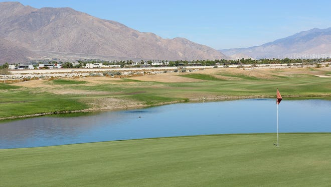 Grass is allowed to go brown on the perimeter of the golf course at Desert Princess Country Club in Cathedral City on Aug. 4, 2015.
