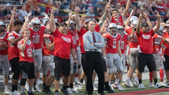 Minerva head coach Mark Hundley watches the action as his team reacts during a 2019 game against Canton South.
