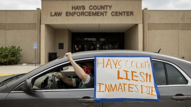 Ryan Cook drives in a caravan of 15 vehicles with activists at the Hays County Law Enforcement Center on Tuesday to demand the release pretrial detainees amid the coronavirus pandemic.
