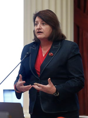 In this photo taken Monday, Jan. 23, 2017, state Sen. Toni Atkins, D-San Diego, addresses the Senate in Sacramento, Calif. Atkins and Sen. Scott Wiener, D-San Francisco, have introduced legislation on Thursday, Jan. 26, 2017, to add a non-binary gender option on state identifying documents including driver's licenses, birth certificates and identity cards. (AP Photo/Rich Pedroncelli)